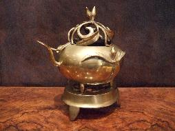 Peach motif Japanese bronze incense burner on a fitted 3 point trivet
